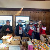 GBMS Volunteers packing Santa stockings
