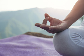 beautiful-young-woman-meditating-and-exercising-on-top-of-him.jpg