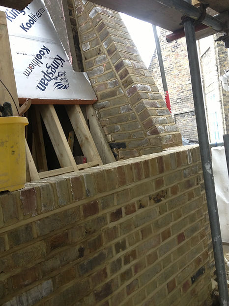 Loft extension in SW1 using imitation Indian stocks that have been brick tinted by C M Brickwork with weather struck pointing.