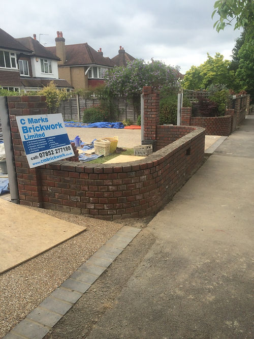 New build garden walls pre pointing and coping stones in Cheam Village.
