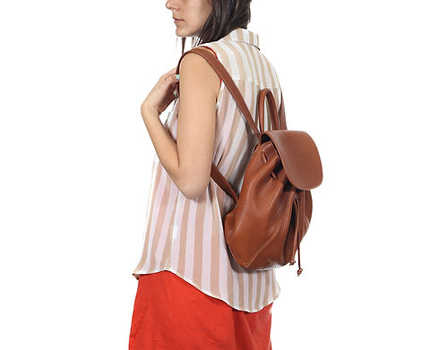 Woman wearing backpack from side