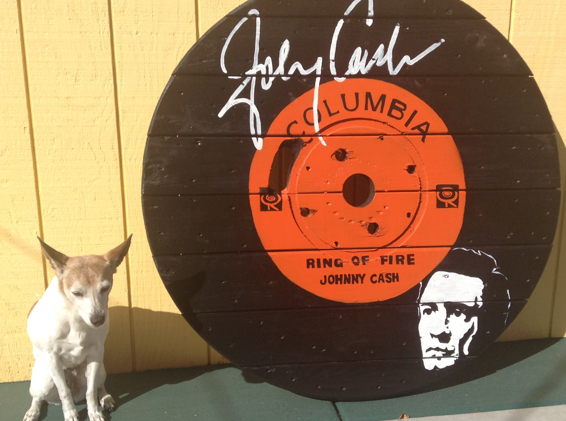 Johnny Cash painting on spool top by artist Carrie Milburn.