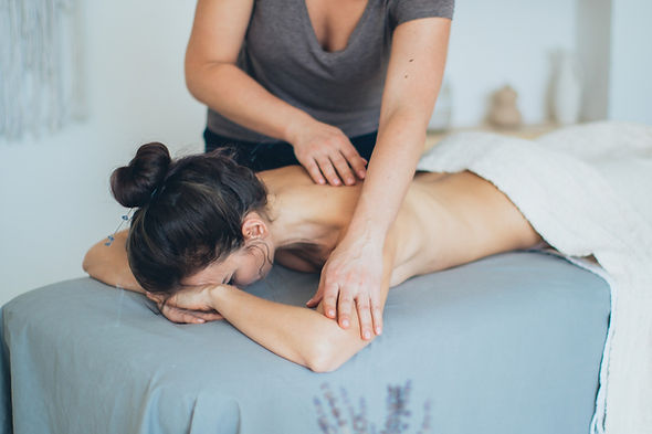 woman-lying-on-bed-while-having-a-massag