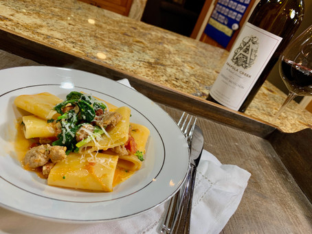 Sausage & Broccoli Rabe over Pasta in a Pink Cream Sauce