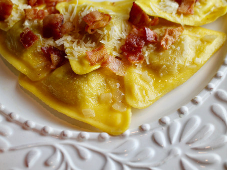 Bacon topped Butternut Squash Ravioli sautéed with Butter & Shallots