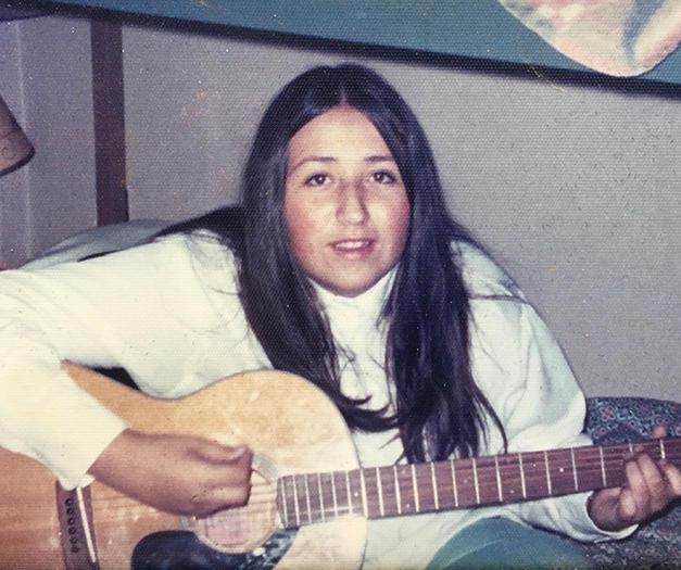 Gen at U of M playing guitar