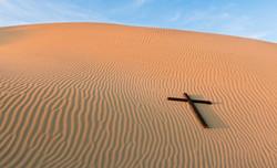 058489552-waves-sand-black-cross