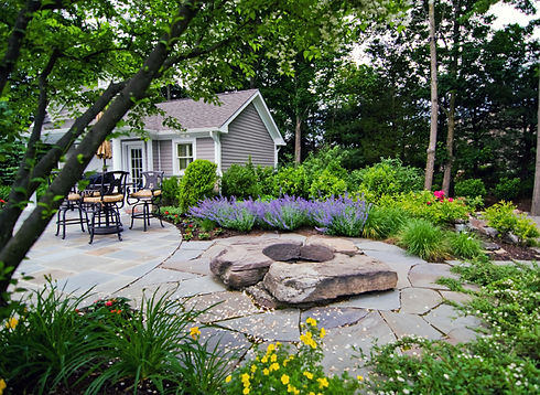 stone-firepit-patio-and-landscaping-idea