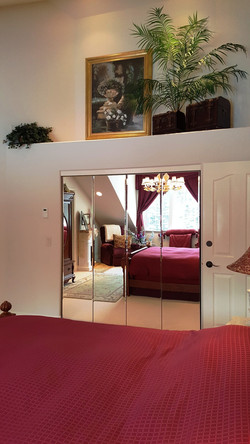 second bedroom mirrored closet