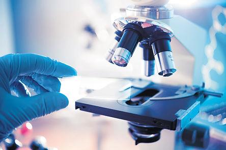 lifesciences_microscope-handholdingslide