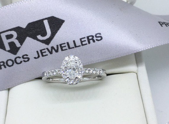18ct White Gold Oval Halo Diamond Ring 0.80ct