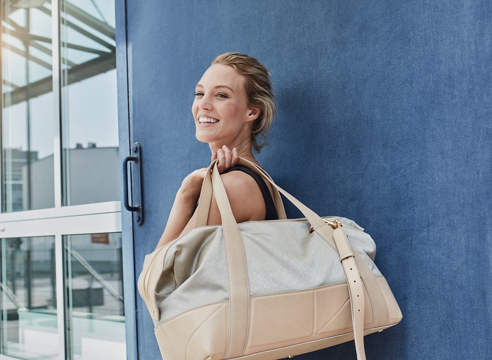 Woman going to the hospital to give birth with her hospital bag packed. Hospital bag must haves