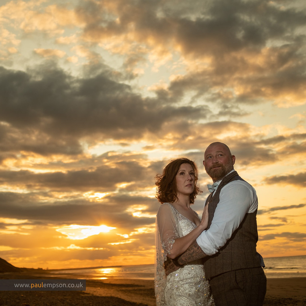 bride & groom in a golden sunset on Saltburn beach