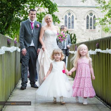 Smiling bride & groom.