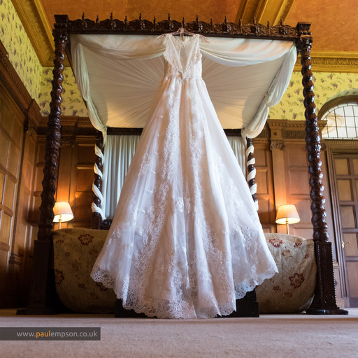 Wedding Dress on four poster bed at Rushpool Hall