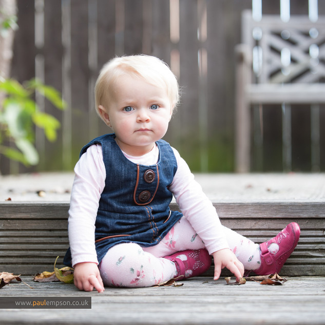 baby sitting in garden