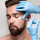 portrait-of-man-being-injected-in-his-face.jpg