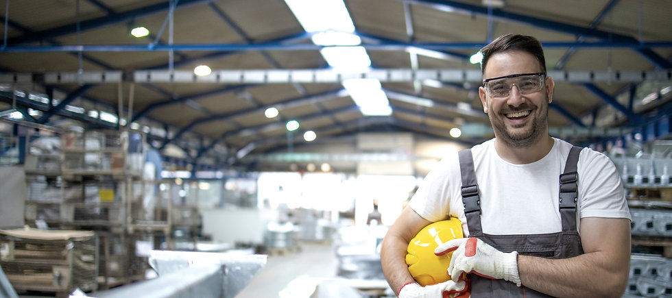 smiling-factory-worker-with-hard-hat-sta