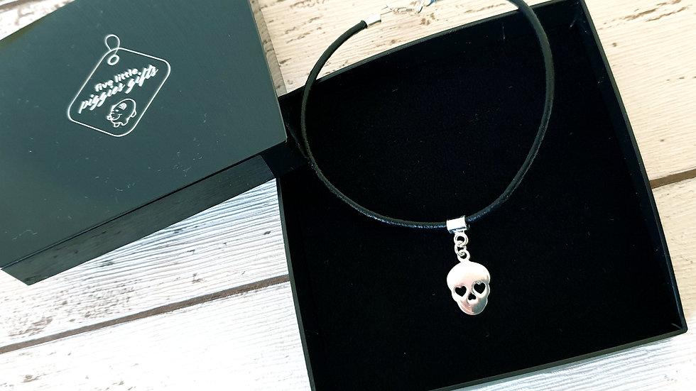 Leather and sterling silver skull bracelet