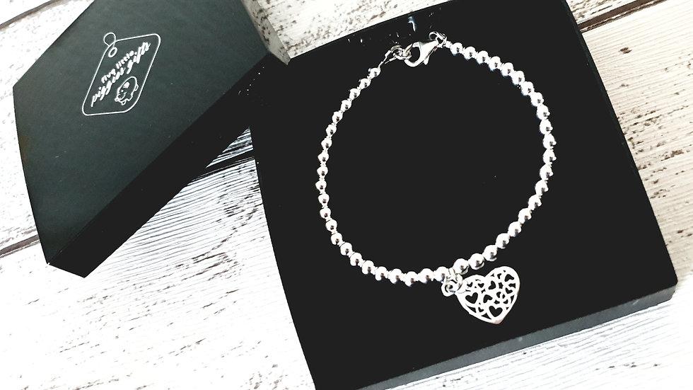 Sterling silver bead filigree heart bracelet