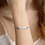 """Thumbnail: Engraved """"Lucy Day Lives"""" Silver Bar Chain Bracelet"""