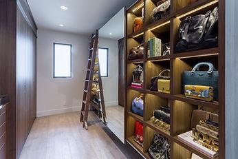 Walnut closet with sliding mirror and ladder