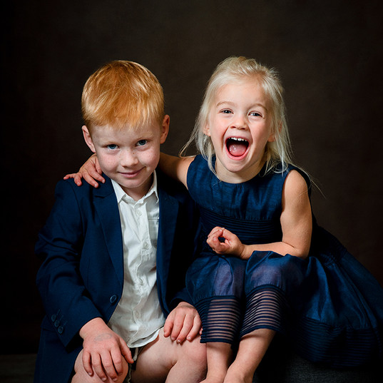 Sibling portrait photograph in the studi