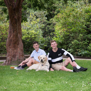 Brothers and family dog in the park