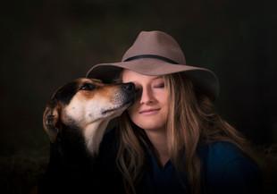 Girl and dog portrait in studio