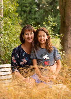 Mother and daughter photograph in the park