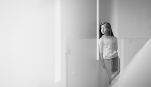Teenage girl photographed in her home