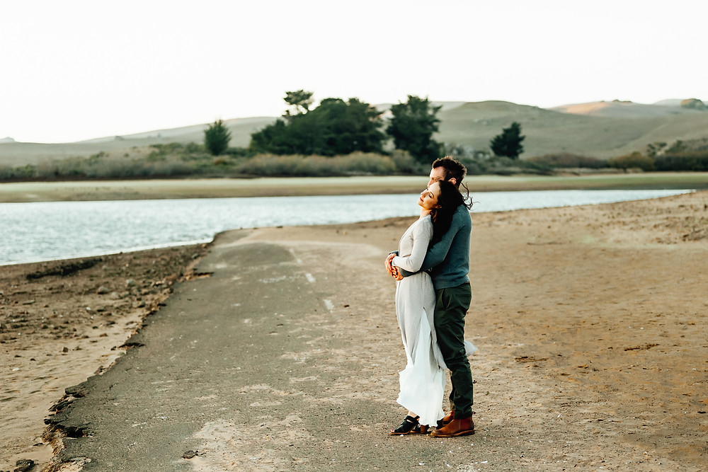 Couple embracing each other enjoying the sunset, mom and dad, holding each other, golden hour, couples photographer, Sonoma County, marin county, Diana Jex, family photographer