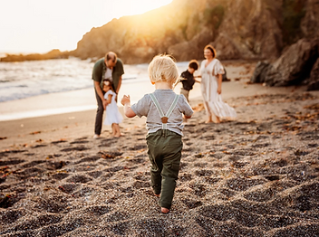 lifestyle beach photo session, northern california family photographer, diana jex photography, toddler boy running to the rest of his family on the beach, golden hour family photo session, bodega CA
