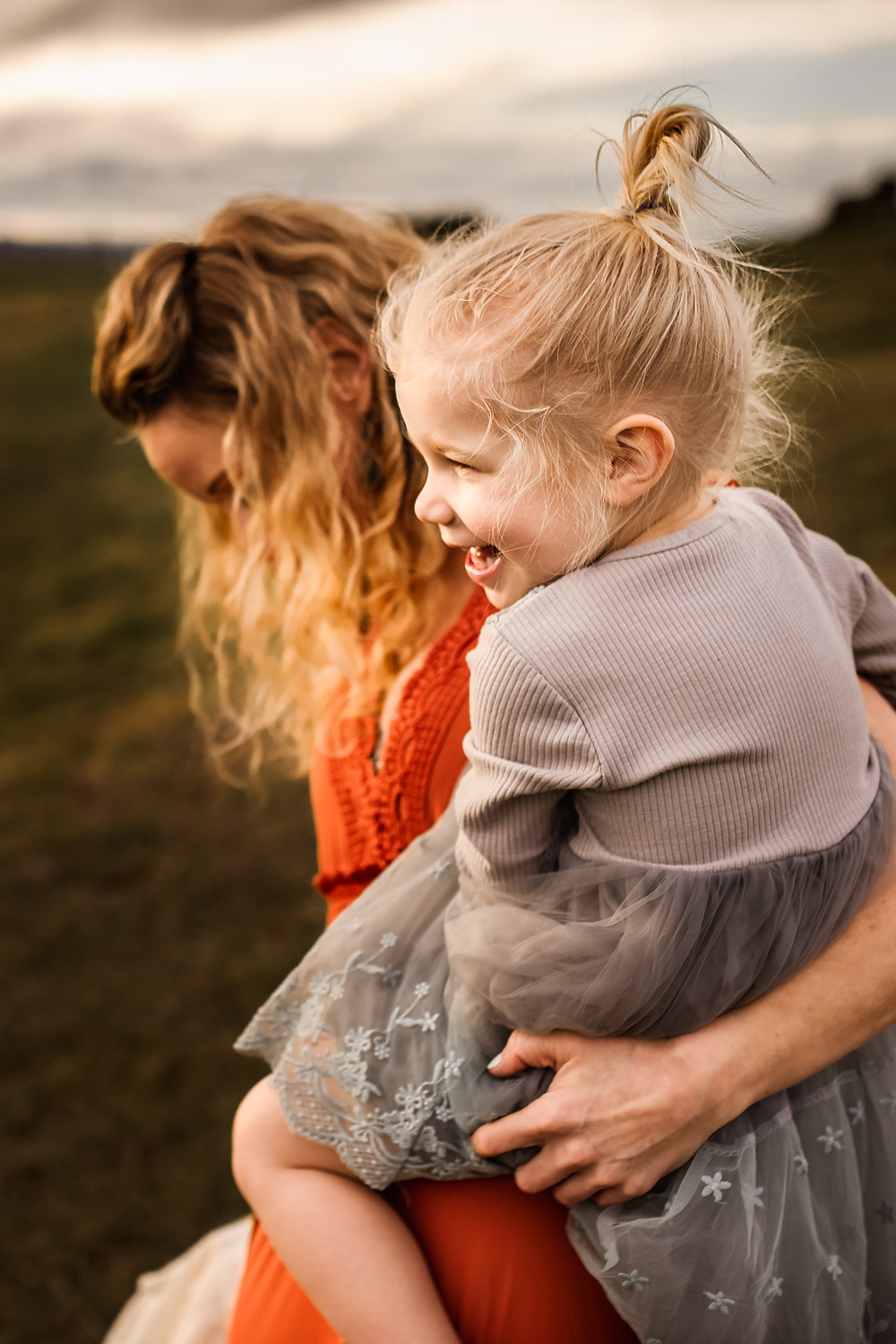 daughter laughing as her mom holds her in her arms, motherhood photo session, family photographer for Sonoma County, Diana Jex Photography
