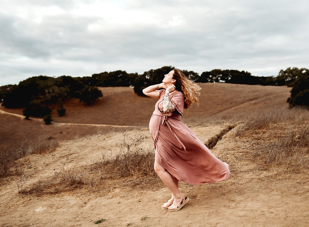 wind blowing in pregnant mom's hair and long pink maxi dress, hair flying in the wind, looking up at the sky, Sonoma County, petaluma maternity photography, petaluma photographer, maternity, Diana Jex