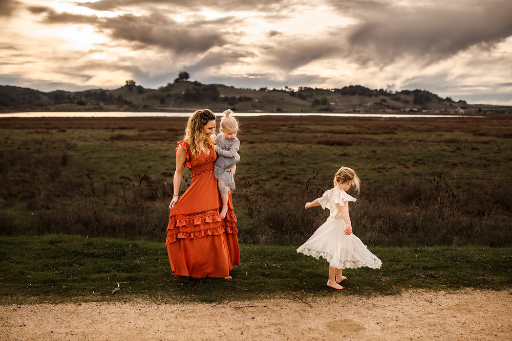 mom and daughters twirling together during a sunset photo session,  motherhood session, petaluma, little girl in white dress from joyfolie, mom in beautiful long maxi dress from Baltic born clothing, family photographer for Sonoma County, Diana Jex Photography