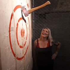 Great Friday night trick axe throw!! smiling Lady is very happy