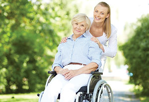 caregiver-helping-elderly.jpg