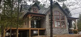 Big house with wrap around deck 1.jpg