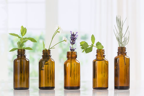 Brown Bottles of essential oil with fres