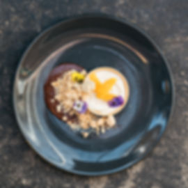 ORANGE CHEESECAKE TART– 14 almond crumble, brandy chocolate sauce