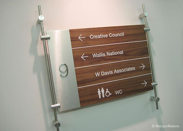 walnut-stainless-floor-directional-offic