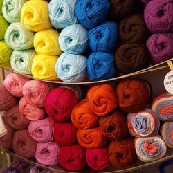 multicoloured balls of wool.