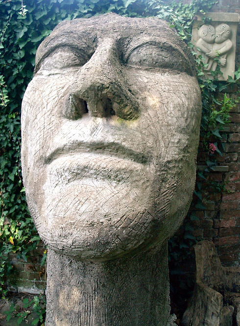Huge still face staring upwards in concrete - model for a future sculpture of the Lady of the Lake.