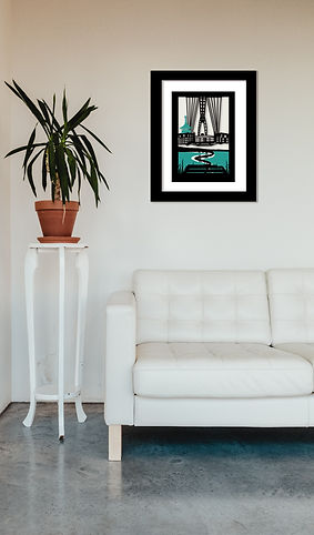 Kirigami image of Newport Transporter Bridge framed and hung above leather sofa.