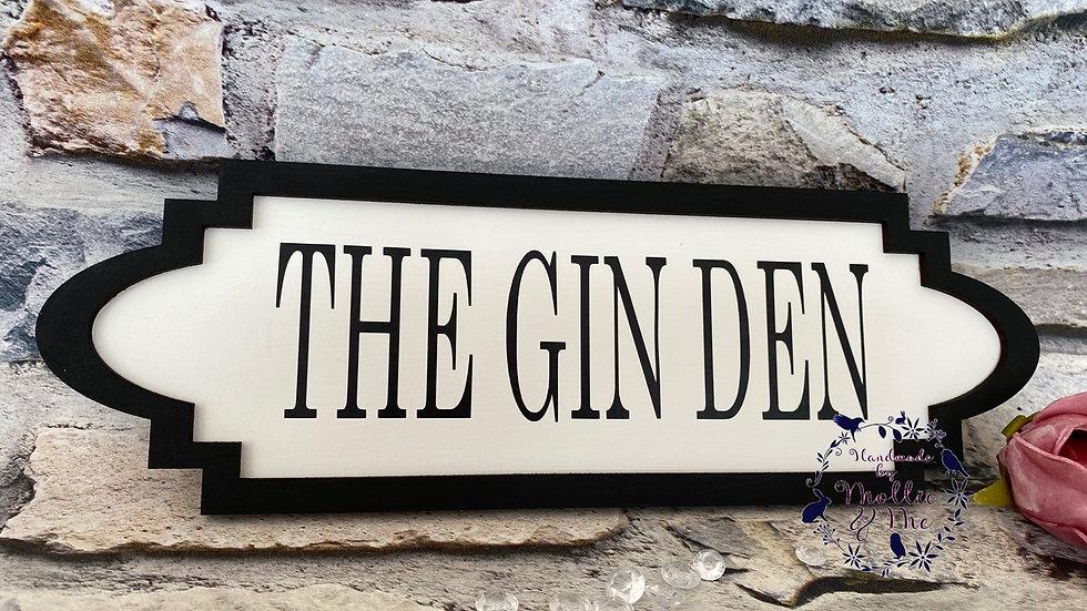 The Gin Den street sign