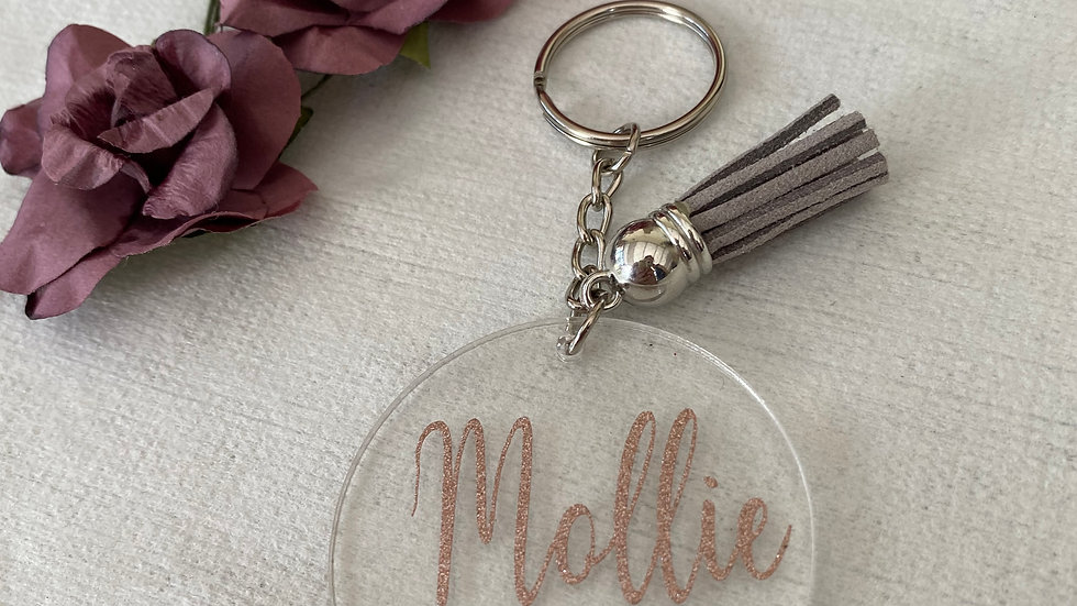 Round keyrings with rose gold vinyl and tassel
