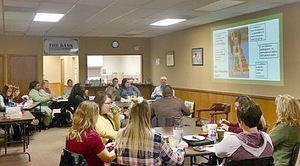 A group of community members in Salem, Missouri meets for discussion