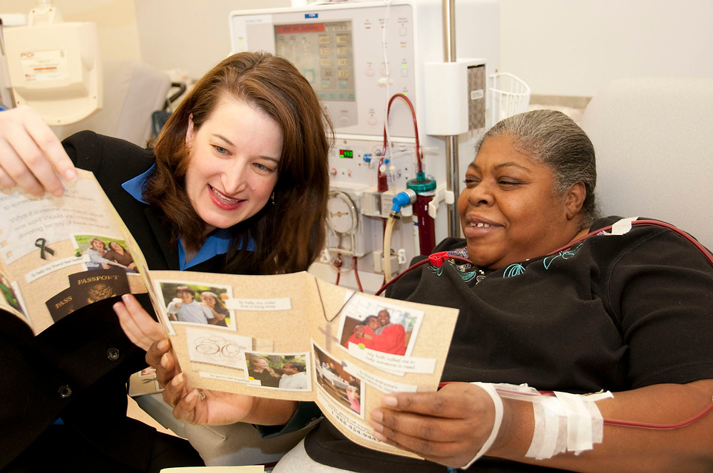 Pictured: Dr. Amy Waterman and a dialysis patient looking through brochure