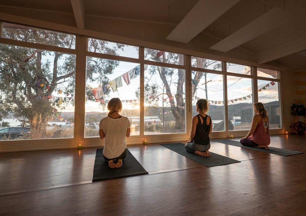 Practice overlooking the lake at Jindabyne Yoga Shala